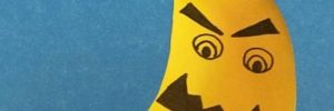 Cropped image of part of a nightmare banana with mean face drawn on. Mouth is dark and jagged, eyes open and glaring