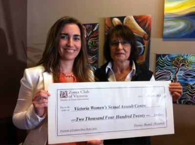 Zonta Club President presents VSAC with proceeds from annual fundraising fashion show.