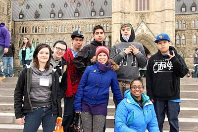 Photo of Rhizome Youth and facilitators on the steps of Parliament in Ottawa
