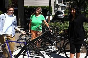 VSAC staff Alyx, Barb and Gagan happily showing off new bike rack at VSAC office