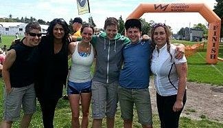 Amy, Gagan, Lara, Alyx, Kingsley, Lenore are all big smiles at the finish line at Tri of Compassion 2014