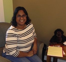 Nadia in her office with with a big smile