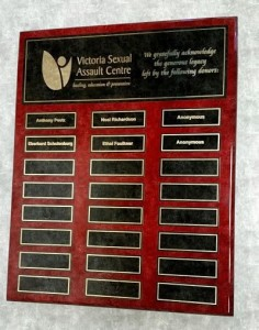 Picture of a donation plaque with the names of some donors on it.