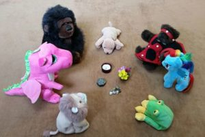 Group of stuffed animals sitting in a circle