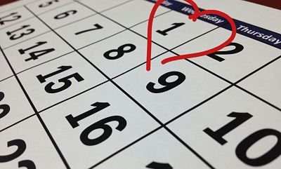 Close up of a page of a calendar with a heart drawn around the 1st