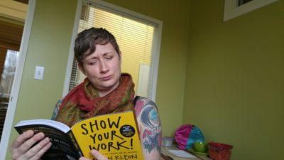 "Kara reading a book called, ""Show your work!"""