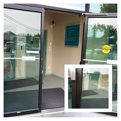 image of automatic doors open on the right side, with a magnified image of the automatic door button